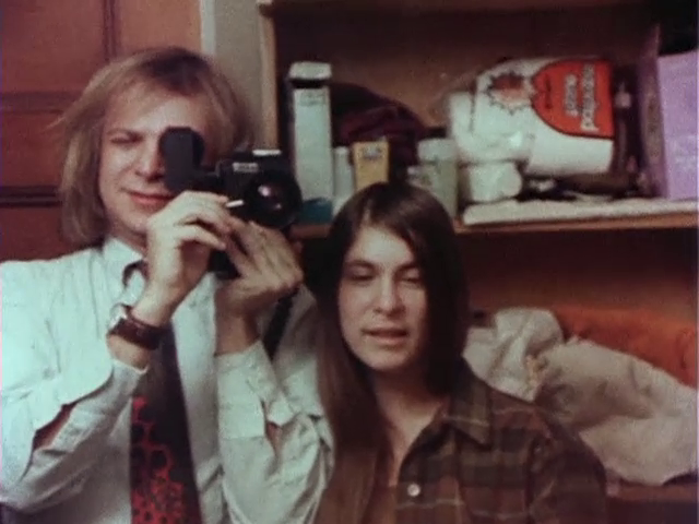 Ed and Jane Pincus, filming themselves in a mirror at their home before they depart for a funural. Diaries (1971-1976) (200 min. color, sound), 1982. Video Still.