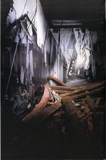 "Figure 4. Detail of the wreckage piled up against the photographic murals. Photo credit: Miyamoto Ryūji. Taken from: Isozaki Arata, ""Frattures,"" Lotus International 93 (1997), 44."
